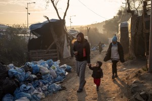 People walk inside the Moria refugee camp on the island of Lesbos in Greece on February 19, 2020. About 20000 migrants and asylum seekers – mostly coming from Afghanistan and Syria – live in the official Moria camp and in the olive grove that is located nearby.