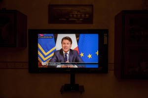 A television tuned on Rai1 during the speech of Italian Prime Minister Giuseppe Conte to announce the closure of all unnecessary production activities to slow the spread of coronavirus in the country in Naples, Italy on March 21, 2020.