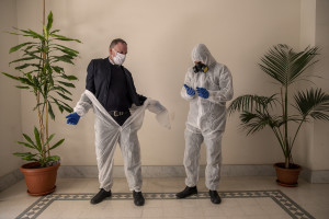 Angelo and Enrico wear protective suits before recovering a person's body during the coronavirus emergency in Naples, Italy on March 27, 2020. The work of funeral agency officials is among those most at risk during this emergency, as often can find in contact with corpses of people who died by coronavirus and the risk of contagion is very high.