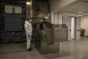 A worker dressing protective suite is seen inside the crematory in Naples, Italy on March 27, 2020. Due to the coronavirus emergency it is no longer possible to celebrate funerals inside churches and funeral processions are prohibited. In the case of cremation, relatives can greet the deceased for the last time through a monitor that shows when the coffin is introduced into the crematorium.