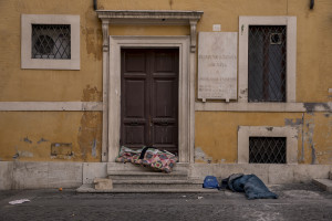 Homeless are seen in Piazza dei Crociferi during the Coronavirus emergency in Rome, Italy on March 30, 2020. Homeless are experiencing a double emergency: the first one due to their condition, the second one linked to the spread of the coronavirus that caused the closure of many assistance centers because of possible contagion.