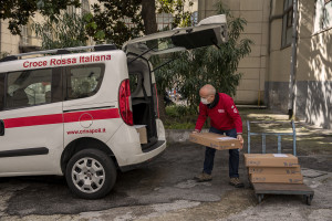 "Patrizio, 53 years old and volunteer of the Italian Red Cross for about 1 years collects medicines to be distributed at home to older people from ""San Gennaro dei Poveri"" hospital, during coronavirus emergency in Naples, Italy on April 2, 2020."