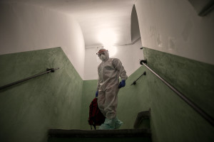 A nurse of the Italian Red Cross is seen after a night intervention at a person's home who suspected to have coronavirus symptoms in Naples, Italy on April 7, 2020.