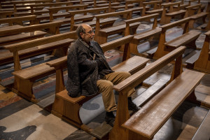 "A man prays inside the empty ""Gesù Nuovo"" church on the third day of unprecedented lockdown across of all Italy imposed to slow the spread of coronavirus in Naples, Southern Italy on March 12, 2020."