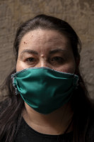 Antonella, 38 years old is portrayed wearing a mask on the eighth day of unprecedented lockdown across of all Italy imposed to slow the spread of coronavirus in Naples, Southern Italy on March 17, 2020.