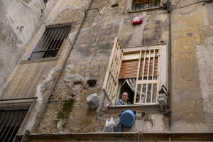 A woman on the balcony  on the eighth day of unprecedented lockdown across of all Italy imposed to slow the spread of coronavirus in Naples, Southern Italy on March 17, 2020.