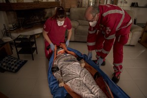 Laura, suspected covid-19 positive is put on a stretcher before being transferred to the hospital after an emergency call to the Italian Red Cross in Nembro, province of Bergamo, Northern Italy on April 12, 2020.
