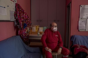 Angelo, ambulance driver is seen during a break inside the Italian Red Cross headquarters in Alzano Lombardo, Norther Italy on April 11, 2020.