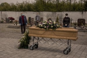 Relatives of a 47 years old man died of coronavirus attend the blessing of his coffin by a priest inside the cemetery of Locate Bergamasco, province of Bergamo, Northern Italy on April 16, 2020.