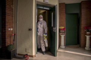 A nurses of the Italian Red Cross is seen before an intervention at a person's home suspected to have coronavirus symptoms in Villa di Serio, province of Bergamo, Northern Italy on April 18, 2020.