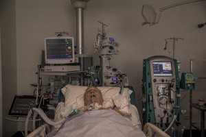 "A patient lies in bed inside the coronavirus intensive care unit of the ""Poliambulanza Foundation"" hospital in Brescia, Italy on April 9, 2020. ""Poliambulanza Foundation"" is a non-profit multispecialist private hospital, affiliated with the National Health Service."