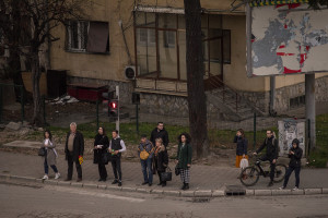 People wait at the traffic lights to be able to cross the street in Skopje, North Macedonia on March 3, 2020. According to the World Health Organization (WHO), 2,574 people die prematurely every year in Macedonia as a result of air pollution. Poor air quality in the Republic of Macedonia is mainly due to the tiny combustion particles called PM10 (10 micrometers or less in diameter) and PM2.5 (2.5 micrometers or less in diameter). These can easily penetrate deeply into the body, causing dangerous health problems and then death.