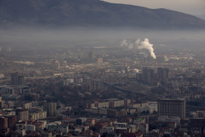 A picture taken from Vodno mountain shows a cloud of pollution over the city of Skopje, North  Macedonia on February 28, 2020. Skopje, located in the center of the Balkan peninsula, is nestled in a valley between mountain ranges that hem the city. The pollution problem is complicated by the inversion of temperature, a natural phenomenon that causes warm air to remain above cold air. This phenomenon creates a blanket of smog that settles heavily over the valley, trapping polluted air on city streets and in the lungs of residents. Sometimes during the winter season the airport is closed due to the presence of toxic fog.