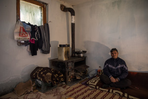 Fadil, 45 years old is portrayed inside his house in the area of Shutka in Skopje, North Macedonia on February 29, 2020. During the winter Fadil, like many others households, burns coal, scrap wood, textiles or trash in order to keep warm. This obsolete heating system is one of the biggest contributors to air pollution in the country. Although the electricity tariffs in Macedonia are among the lowest in Europe, energy can cost a third or even half of a citizen's  average monthly salary. This is the reason why many residents burn wood to heat their home, often buying it on the black market where it costs less, but is more toxic to the environment.