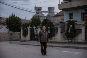 """Bosko, 74 years old is portrayed in front of the """"Usje"""" cement factory where his home is located in Skopje, North Macedonia on March 2, 2020. According to green activists """"Usje"""" cement factory uses waste as fuel during its production cycle. One of the main causes of air pollution in Skopje are the industries, in general older than in the rest of Europe. As reported on the website republika.mk the company confirmed that it is using petroleum coke and former employees have recently claimed that it was also burning old car tires brought in from Greece. The area around """"Usje"""" cement factory has some of the worst levels of air pollution in Skopje."""