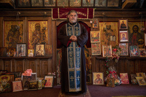 The priest and environmental activist Dusco Gruevski is portrayed inside the Saint Atanasij Orthodox church in Novatsi, North Macedonia on March 1, 2020. Dusco, 50 years old, was born in Bitola and has been taking medicine for ten years to control respiratory problems of which he suffers and which have caused him two pulmonary infarcts. Dusco believes that his health problems are related to environmental pollution.