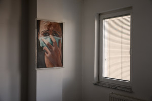 """A painting by Merve Sulejmani showing a woman with mask is seen inside """"Eco Guerilla"""" headquarter in Tetovo, North Macedonia on March 2, 2020. """"Eco Guerilla"""" is an environmental movement born in November 2013 that mainly deals with air pollution."""