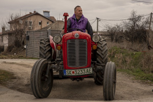 """A farmer is portrayed aboard his tractor near """"Usje"""" cement factory in Skopje, North Macedonia on March 3, 2020. According to green activists """"Usje"""" cement factory uses waste as fuel during its production cycle. One of the main causes of air pollution in Skopje are the industries, in general older than in the rest of Europe. As reported on the website republika.mk the company confirmed that it is using petroleum coke and former employees have recently claimed that it was also burning old car tires brought in from Greece. The area around """"Usje"""" cement factory has some of the worst levels of air pollution in Skopje."""