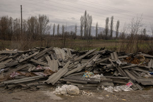 """An illegal asbestos dump in Skopje, North Macedonia on March 4, 2020. The presence of asbestos fibers in the environment inevitably involves damage to health, even in the presence of a few fibrous elements. Particularly harmful to health is fiber cement (better known as """"eternit""""), a mixture of asbestos and particularly friable cement and therefore subject to damage or crushing. The greatest risks are related to the presence of fibers in the air. Once inhaled, the fibers can be deposited inside the airways and on lung cells. The fibers that have settled in the deepest parts of the lung can remain in the lungs for several years, even for a lifetime. The presence of these foreign fibers inside the lungs can lead to the onset of diseases such as asbestosis, mesothelioma and lung cancer."""