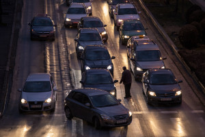 A man asks for alms among the cars stuck in traffic in Skopje, North Macedonia on March 3, 2020. Traffic also contributes to air pollution, but the lack of an official census since 2002, however, makes hard to quantify the problem.