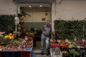 """A greengrocer in the """"Quartieri Spagnoli"""" in Naples, Italy on June 16, 2020. Popular neighborhoods are those that more than others are suffering from the economic crisis generated by the coronavirus. The rate of poverty and unemployment that was higher than the national average in Southern Italy even before the pandemic, increased following the lockdown imposed by the government to counter the spread of the coronavirus, which blocked the country's economy for more than two months."""