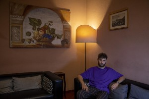 """A portrait of Sergio Cafora, 23 years old and manager of the Toledo hotel in Naples, Italy on July 9, 2020. The Toledo hotel located in the heart of the """"Quartieri Spagnoli"""", welcomed the last customer on March 10,2020 and then remained closed for three months due to the restrictive measures imposed by the Italian government to reduce the spread of the coronavirus. The tourism sector remains among those most affected by the pandemic."""
