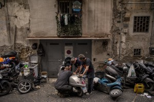"""Mechanics at work in the """"Quartieri Spagnoli"""" in Naples, Italy on June 16, 2020. Popular neighborhoods are those that more than others are suffering from the economic crisis generated by the coronavirus. The rate of poverty and unemployment that was higher than the national average in Southern Italy even before the pandemic, increased following the lockdown imposed by the government to counter the spread of the coronavirus, which blocked the country's economy for more than two months."""