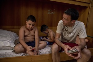 """Gaetano Ippolito (right) 46 years old is seen with his sons Ciro (left) 7 years old and Diego (center) 5 years old in the house where they live in the """"Rione Sanità"""" in Naples, Italy on June 17, 2020. Since the pandemic broke out, Gaetano has no longer been able to find any type of job, even on an occasional basis. Popular neighborhoods are those that more than others are suffering from the economic crisis generated by the coronavirus. The rate of poverty and unemployment that was higher than the national average in Southern Italy even before the pandemic, increased following the lockdown imposed by the government to counter the spread of the coronavirus, which blocked the country's economy for more than two months."""