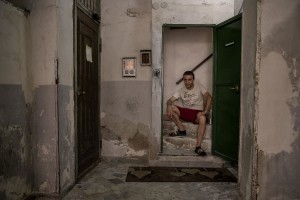 """Gaetano Ippolito, 46 years old is portrayed at the entrance of his house in the """"Rione Sanità"""" in Naples, Italy on June 17, 2020. Since the pandemic broke out, Gaetano has no longer been able to find any type of job, even on an occasional basis. Popular neighborhoods are those that more than others are suffering from the economic crisis generated by the coronavirus. The rate of poverty and unemployment that was higher than the national average in Southern Italy even before the pandemic, increased following the lockdown imposed by the government to counter the spread of the coronavirus, which blocked the country's economy for more than two months."""