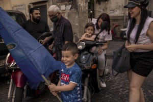 """People are seen in the """"Rione Sanità"""" in Naples, Italy on June 17, 2020. Popular neighborhoods are those that more than others are suffering from the economic crisis generated by the coronavirus. The rate of poverty and unemployment that was higher than the national average in Southern Italy even before the pandemic, increased following the lockdown imposed by the government to counter the spread of the coronavirus, which blocked the country's economy for more than two months."""