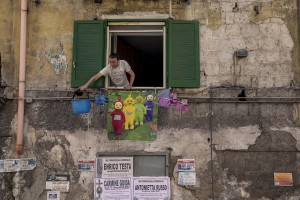 """Gaetano Ippolito, 46 years old looking out the window of the house where he lives in the """"Rione Sanità"""" in Naples, Italy on June 17, 2020. Since the pandemic broke out, Gaetano has no longer been able to find any type of job, even on an occasional basis. Popular neighborhoods are those that more than others are suffering from the economic crisis generated by the coronavirus. The rate of poverty and unemployment that was higher than the national average in Southern Italy even before the pandemic, increased following the lockdown imposed by the government to counter the spread of the coronavirus, which blocked the country's economy for more than two months."""