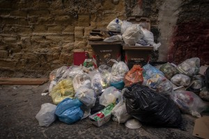 """Garbage is seen in a street of the """"Rione Sanità"""" in Naples, Italy on June 17, 2020. Popular neighborhoods are those that more than others are suffering from the economic crisis generated by the coronavirus. The rate of poverty and unemployment that was higher than the national average in Southern Italy even before the pandemic, increased following the lockdown imposed by the government to counter the spread of the coronavirus, which blocked the country's economy for more than two months."""
