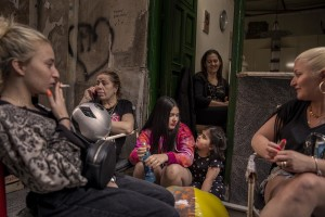 """Women and girls are seen outside a typical Neapolitan house called """"basso"""" in the """"Quartieri Spagnoli"""" in Naples, Italy on June 16, 2020. Popular neighborhoods are those that more than others are suffering from the economic crisis generated by the coronavirus. The rate of poverty and unemployment that was higher than the national average in Southern Italy even before the pandemic, increased following the lockdown imposed by the government to counter the spread of the coronavirus, which blocked the country's economy for more than two months."""