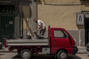 """A man at work in the """"Rione Sanità"""" in Naples, Italy on June 17, 2020. Popular neighborhoods are those that more than others are suffering from the economic crisis generated by the coronavirus. The rate of poverty and unemployment that was higher than the national average in Southern Italy even before the pandemic, increased following the lockdown imposed by the government to counter the spread of the coronavirus, which blocked the country's economy for more than two months."""