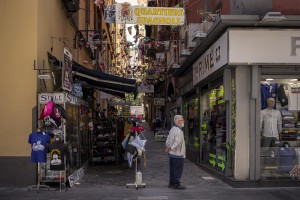 """A man is seen in a street of of the """"Quartieri Spagnoli"""" in Naples, Italy on June 15, 2020. Popular neighborhoods are those that more than others are suffering from the economic crisis generated by the coronavirus. The rate of poverty and unemployment that was higher than the national average in Southern Italy even before the pandemic, increased following the lockdown imposed by the government to counter the spread of the coronavirus, which blocked the country's economy for more than two months."""