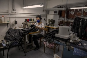 """A woman at work inside the """"GF"""" factory in Naples, Italy on June 30, 2020. The """"GF"""" is an Italian factory that produces leather clothing and tailored suits. After the end of the lockdown and the consequent reopening of commercial activities, the """"GF"""" factory saw its revenues drop by almost 50% and was forced to put some employees into layoffs."""