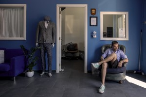 """A man sits on a sofa of the """"GF"""" factory in Naples, Italy on June 30, 2020. The """"GF"""" is an Italian factory that produces leather clothing and tailored suits. After the end of the lockdown and the consequent reopening of commercial activities, the """"GF"""" factory saw its revenues drop by almost 50% and was forced to put some employees into layoffs."""