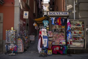 A newsstand without customers is seen in Toledo street in Naples, Italy on June 15, 2020. Popular neighborhoods are those that more than others are suffering from the economic crisis generated by the coronavirus. The rate of poverty and unemployment that was higher than the national average in Southern Italy even before the pandemic, increased following the lockdown imposed by the government to counter the spread of the coronavirus, which blocked the country's economy for more than two months.
