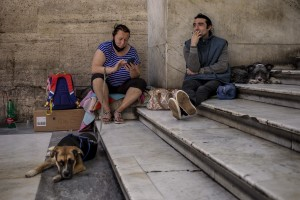 Homeless and their dogs are see inside the Umberto I gallery in Naples, Italy on June 15, 2020. During the lockdown imposed by the Italian government to contain the spread of coronavirus, homeless experienced a double emergency: the first one due to their condition, the second one linked to the closure of many assistance centers because of possible contagion.