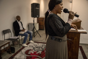Princess Inyang Okokon (right) celebrates the Sunday mass inside a Pentecostal church in Asti, Northern Italy on January 12, 2020. Princess illegally entered Italy in 1998 as a victim of human trafficking. When she met her future husband Alberto Mossino she was able to pay off her debt of 45000 euros with the madame and interrupt that kind of life. In 2000, together with Alberto, she decided to found the non-profit organization Piam (migrant reception integration project) to help foreign girls victims of human trafficking.
