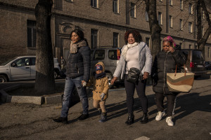 Princess Inyang Okokon (left) and some of her collaborators accompany the son of one of the girls hosted by the Piam non-profit organization to school in Asti, Northern Italy on January 9, 2020.