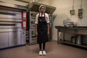 """A portrait of Glory, 21 years old from Edo State, Nigeria inside the company """"Al volo"""" where she has been doing an internship for 5 months in Monale, in the province of Asti, Northern Italy, on January 13, 2020."""