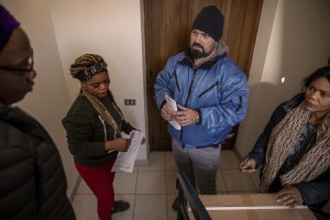 A bellhop delivers food to the headquarters of the Piam non-profit organization in Asti, Northern Italy on January 9, 2020.