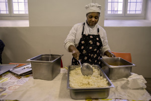 Destiny prepares food for the girls hosted by the non-profit organization Piam in Asti, Northern Italy on January 10, 2020.