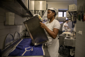 Vivian, 23 years old from Delta State, Nigeria is seen at work inside the kitchen of the Bar Carducci where she carries out her internship in Asti, Northern Italy on January 9, 2020. Vivian has been in Italy for 3 years and settled in Asti since two. Like Vivian, other girls rescued from the street have obtained asylum seeker status and have joined the SPRAR project (protection system for asylum seekers and refugees).