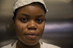 A portrait of Vivian, 23 years old from Delta State, Nigeria inside the kitchen of the Bar Carducci where she carries out her internship in Asti, Northern Italy on January 9, 2020. Vivian has been in Italy for 3 years and settled in Asti since two. Like Vivian, other girls rescued from the street have obtained asylum seeker status and have joined the SPRAR project (protection system for asylum seekers and refugees).