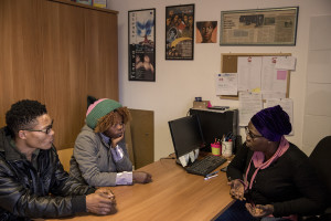 Faith, 29 years old from Delta State, Nigeria and her boyfriend John, 31 years old from Nigeria hold an interview with Fatima (one of the managers of the Piam non-profit organization) to discuss their work situation and their progress in learning Italian language in Asti, Northern Italy on January 10, 2020.