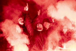 People are seen near pictures of the Argentine soccer legend Diego Armando Maradona in the Spanish Quarter after the announcement of his death, in Naples, Italy on November 26, 2020.