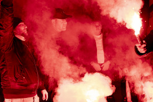 A man is seen near pictures of the Argentine soccer legend Diego Armando Maradona in the Spanish Quarter after the announcement of his death, in Naples, Italy on November 26, 2020.