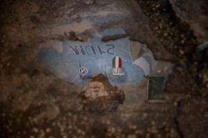 A funeral poster announcing the death of the Argentine soccer legend Diego Armando Maradona is seen on a wall in the historic center of Naples, Italy on November 28, 2020.